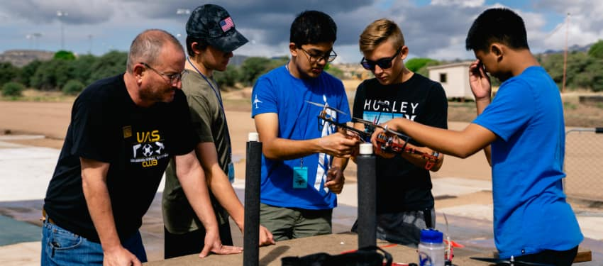 students work on a drone